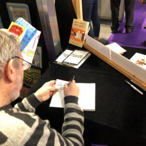 Michael Rosen signing books
